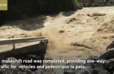 Massive flooding causes section of SW China highway to collapse