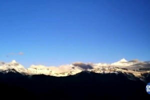 Sunrise over snowy mountains in Yunnan
