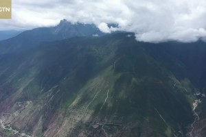 Bird's eye view of Shangri-la: The holy mountain hidden in the clouds