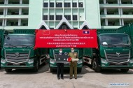 China hands over law enforcement vehicles in assistance to Laos