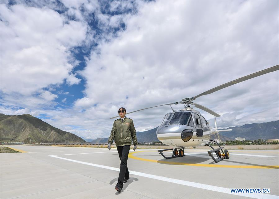 Female pilot from impoverished family flies helicopter in China's Tibet