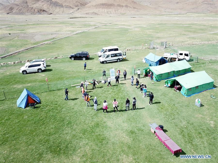 Tourists from Lhasa join group tour at Yamzbog Yumco Lake scenic area in Shannan