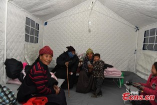 People evacuated to tents in quake-hit county