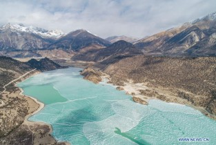 Aerial view of ice-covered Ra'og Lake in Qamdo, Tibet